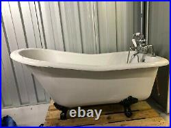 Free standing roll top slipper bath with black claw feet